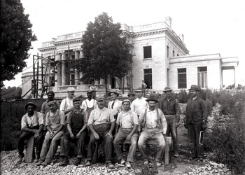 Work crew poses in front of the new mansion.